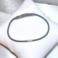 Bracelet cuir tress� rond fin gris