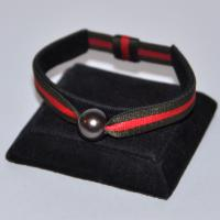 Bracelet réglable stretch kaki/rouge 1 perle